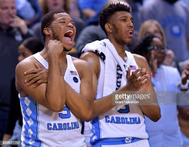 Kennedy Meeks and Tony Bradley of the North Carolina Tar Heels cheer on their teammates during the game against the Notre Dame Fighting Irish at the...