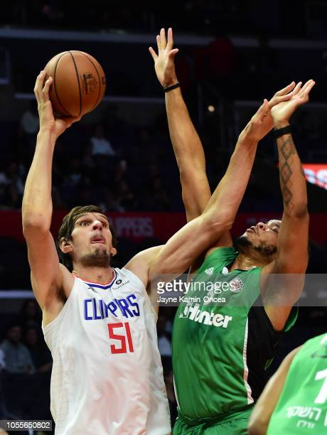 Kennedy Meeks of Maccabi Haifa guards Boban Marjanovic of the Los Angeles Clippers as he shoots a basket in the game at Staples Center on October 11...