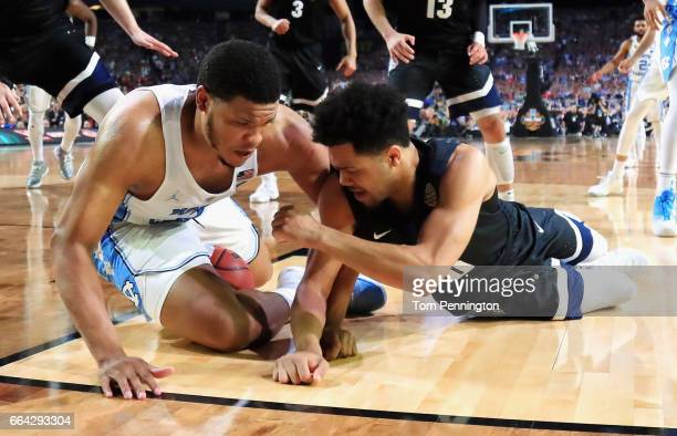 Kennedy Meeks of the North Carolina Tar Heels and Silas Melson of the Gonzaga Bulldogs compete for the ball in the second half during the 2017 NCAA...