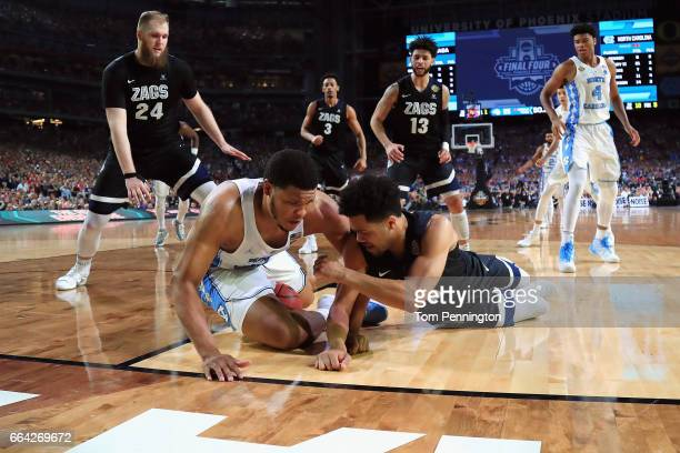 Kennedy Meeks of the North Carolina Tar Heels anfd Silas Melson of the Gonzaga Bulldogs compete for the ball in the second half during the 2017 NCAA...