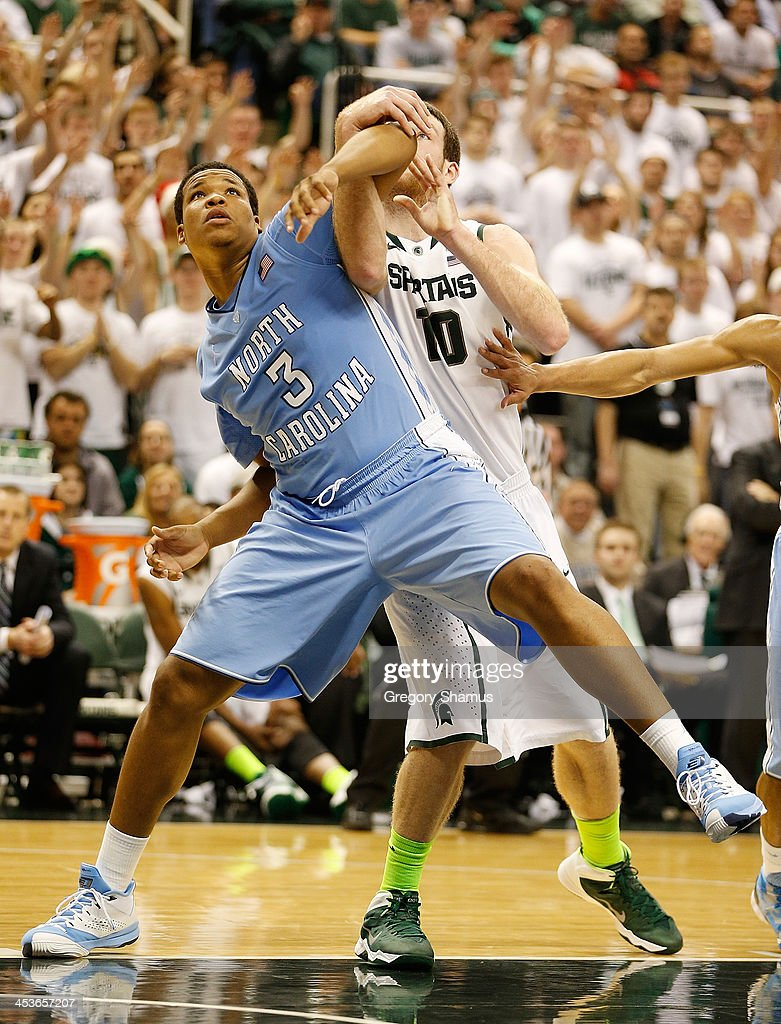 Kennedy Meeks #3 of the North Carolina Tar Heels battles for a rebound with Matt Costello #10 of the Michigan State Spartans during the second half at the Jack T. Breslin Student Events Center on December 4, 2013 in East Lansing, Michigan. North Carolina won the game 79-65.