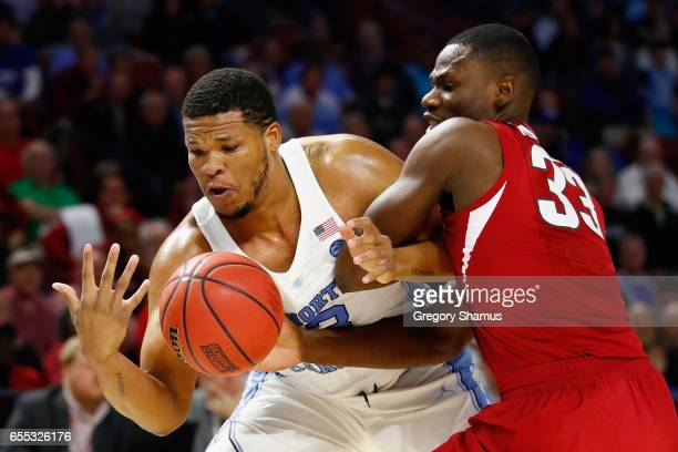 Kennedy Meeks of the North Carolina Tar Heels battles for the ball with Moses Kingsley of the Arkansas Razorbacks in the first half during the second...