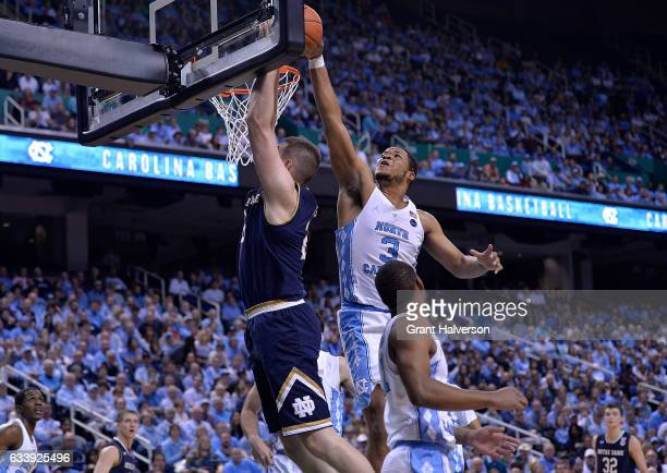 Kennedy Meeks of the North Carolina Tar Heels blocks a shot by Martinas Geben of the Notre Dame Fighting Irish during the game at the Greensboro...