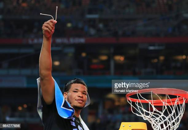 Kennedy Meeks of the North Carolina Tar Heels cuts the net after defeating the Gonzaga Bulldogs during the 2017 NCAA Men's Final Four National...