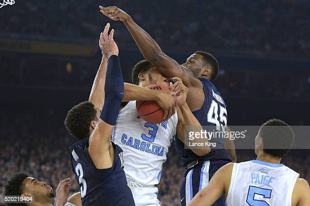 Kennedy Meeks of the North Carolina Tar Heels gets a defensive rebound against Josh Hart and Darryl Reynolds of the Villanova Wildcats during the...
