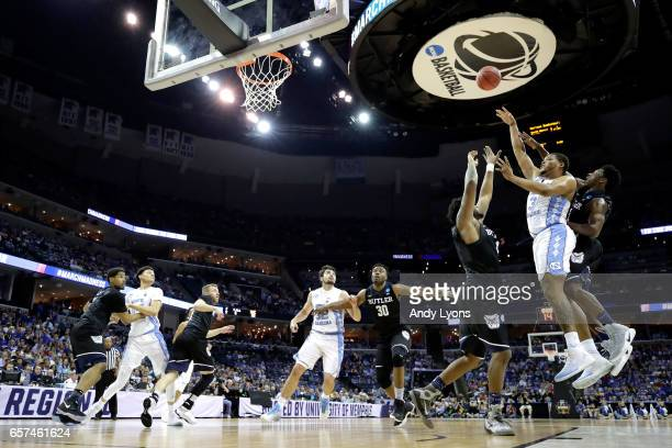 Kennedy Meeks of the North Carolina Tar Heels shoots against Tyler Wideman and Kamar Baldwin of the Butler Bulldogs in the first half during the 2017...