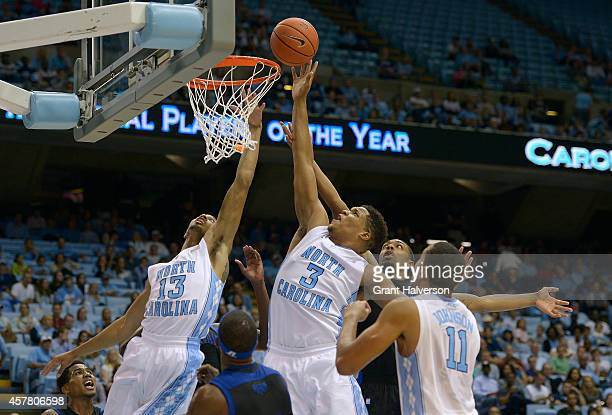 Kennedy Meeks of the North Carolina Tar Heels tips in a rebound against the Fayetteville State University Broncos during their game at the Dean Smith...