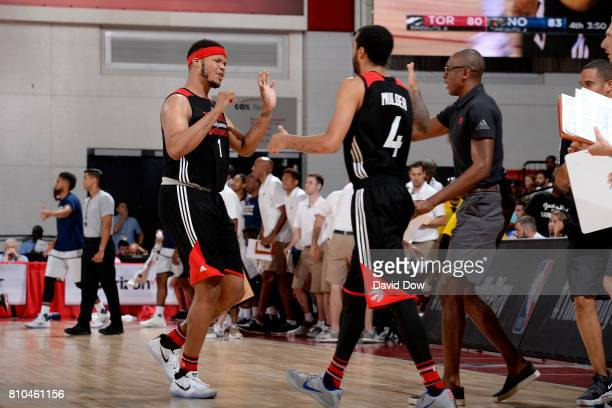 Kennedy Meeks of the Toronto Raptors high fives Mychal Mulder and Patrick Mutombo of the Toronto Raptors during the game against the New Orleans...