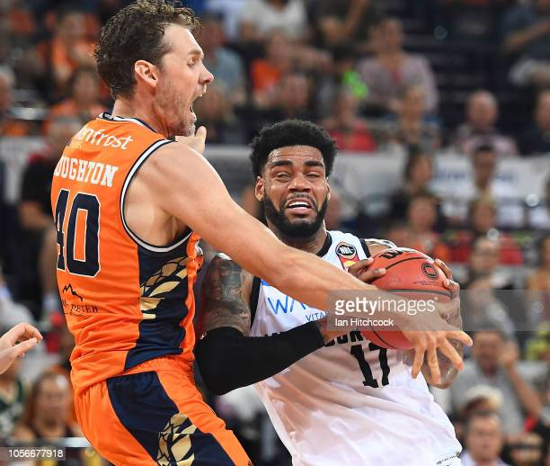 Kennedy of Melbourne United drives to the basket past Alex Loughton of the Taipans during the round four NBL match between the Cairns Taipans and...