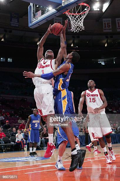 J Kennedy of St John's Red Storm goes up for a shot against Greg Washington of Hofstra Pride at Madison Square Garden on December 20 2009 in New York...