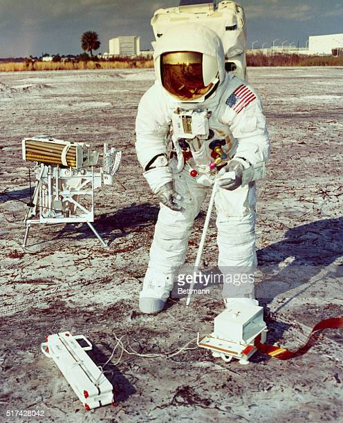 Kennedy Space Center Fla Apollo 13 Spacecraft Commander James A Lovell Jr prepares to assemble lunar drill during a practice Moonwalk The National...