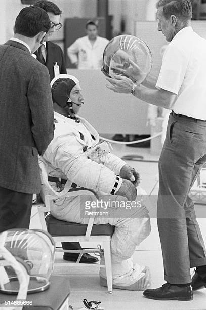 Kennedy Space Center Florida Having been fitted with a space suit astronaut James Lovell gets a dandy space helmet to go with It was suitingup day at...