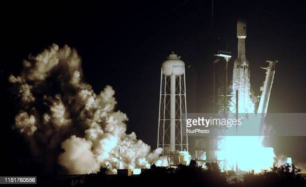 Kennedy Space Center, Florida, United States - A SpaceX Falcon Heavy rocket carrying satellites for the U.S. Air Force successfully launches from pad...