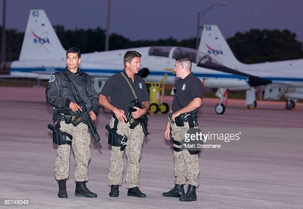 Kennedy Space Center security watch the airfield where the Space Shuttle Discovery astronauts will park their T38 aircraft after landing at the KSC...