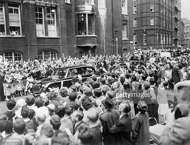 Kennedy's Enroute To Christening London Crowds cheer automobile carrying President John Kennedy and his wife Jacqueline to Westminister Cathedral...