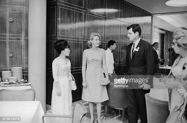 Kennedy's Meet Mrs. Nhu. Belgrade, Yugoslavia: Sen. Edward M. Kennedy and his wife, Joan , chat with Mrs. Ngo Dinh Nhu after attending a luncheon...
