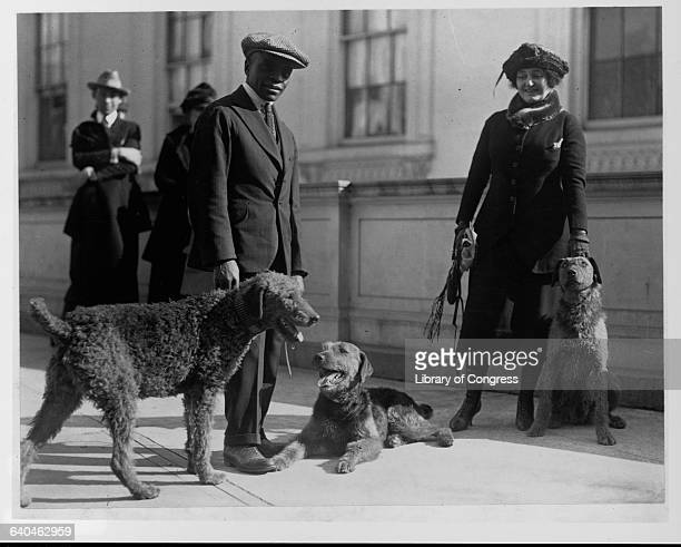A kennel keeper and a woman with President Harding's airdales Washington DC