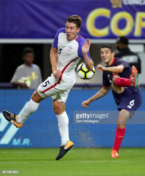 Kenner Gutierrez of Costa Rica deflects a kist by Kelyn Rowe of United States during the 2017 CONCACAF Gold Cup Semifinal at ATT Stadium on July 22...