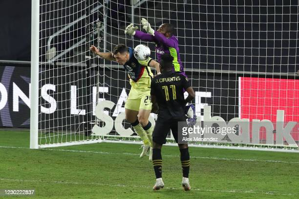 Kennerth Vermeer of Los Angeles FC makes a save against Federico Vinas of Club America as Jose Cifuentes of Los Angeles FC looks on during the...