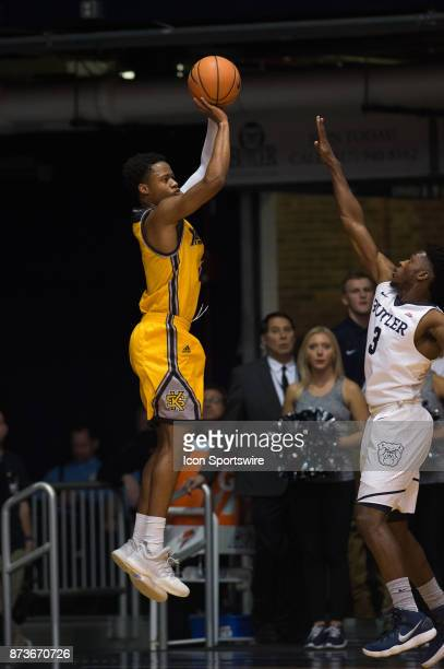 Kennesaw State Owls guard James Scott shoots a three pointer over Butler Bulldogs guard Kamar Baldwin during the men's college basketball game...