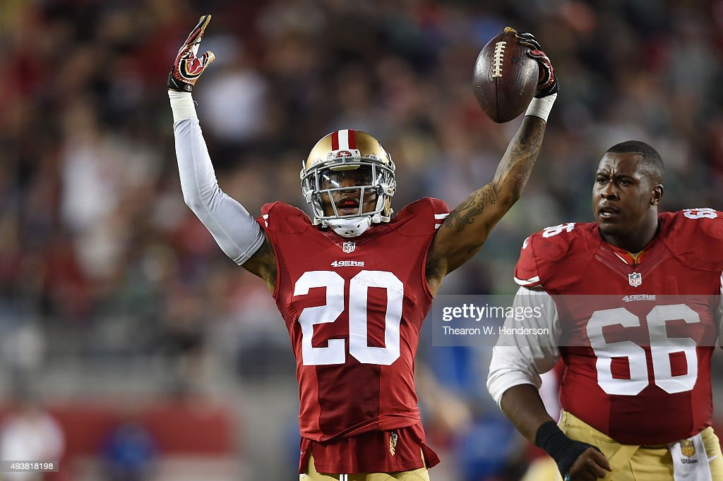Kenneth Acker #20 of the San Francisco 49ers celebrates after intercepting a pass by Russell Wilson #3 of the Seattle Seahawks in the third quarter of their NFL game at Levi's Stadium on October 22, 2015 in Santa Clara, California.