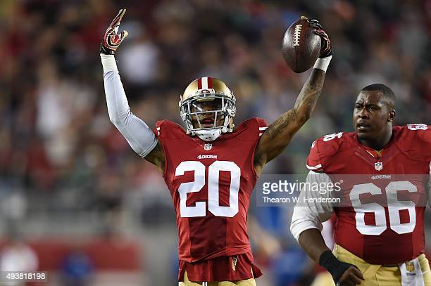 Kenneth Acker of the San Francisco 49ers celebrates after intercepting a pass by Russell Wilson of the Seattle Seahawks in the third quarter of their...