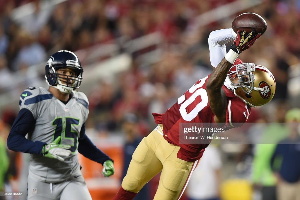 Kenneth Acker #20 of the San Francisco 49ers intercepts a pass by Russell Wilson #3 of the Seattle Seahawks in the third quarter of their NFL game at Levi's Stadium on October 22, 2015 in Santa Clara, California.
