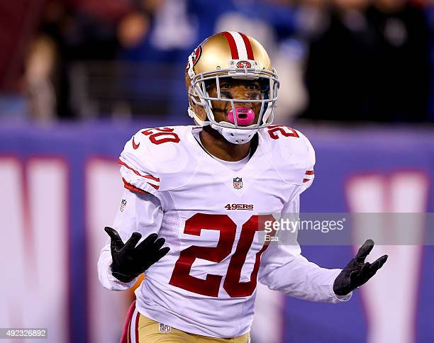 Kenneth Acker of the San Francisco 49ers reacts after he is called for pass interference in the fourth quarter against the New York Giants at MetLife...