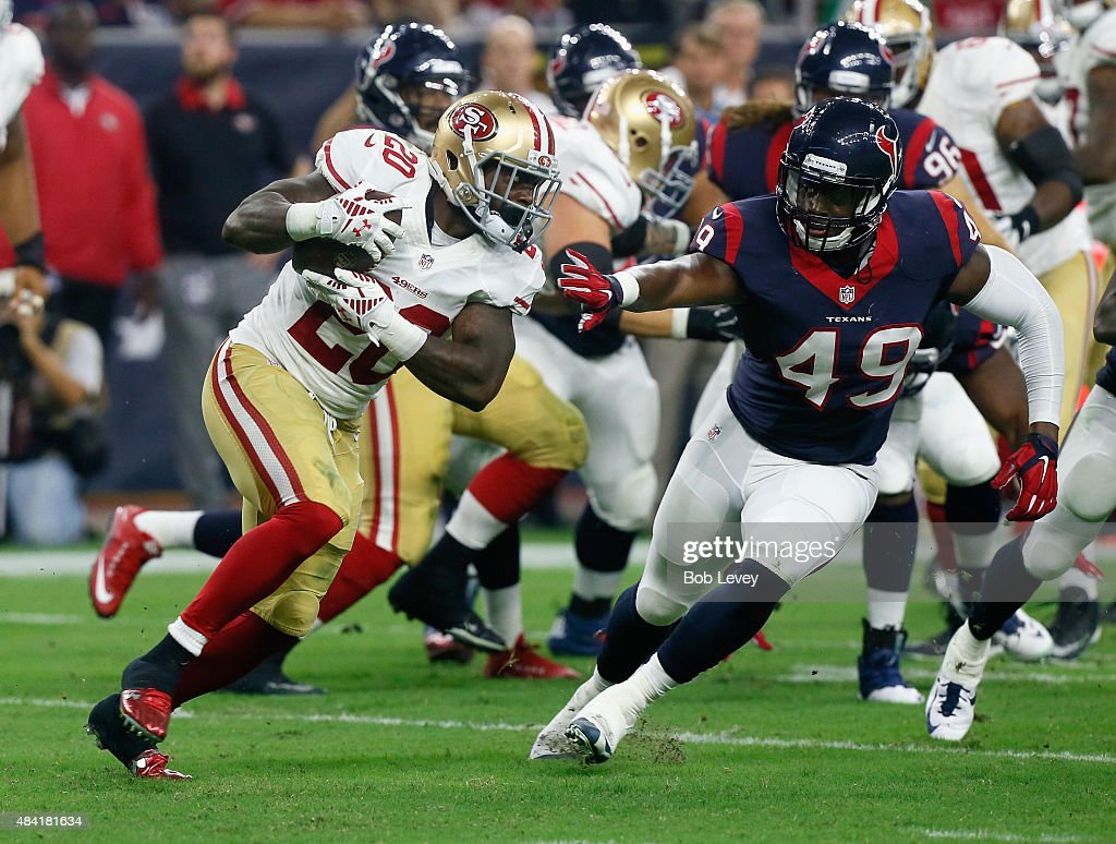 Kenneth Acker #20 of the San Francisco 49ers rushes past Tony Washington #49 of the Houston Texans in the fourth quarter at Reliant Arena at Reliant Park on August 15, 2015 in Houston, Texas.