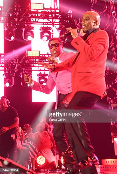 Kenneth Babyface Edmonds and Ralph Tresvant perform onstage at 2016 Essence Festival at Louisiana Superdome on July 1 2016 in New Orleans Louisiana