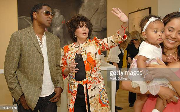 Kenneth 'Babyface' Edmonds Carole Bayer Sager and Nicole Patenburg holding daughter Peyton Edmonds attend Wounded curated by Carole Bayer Sager at LA...