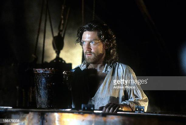 Kenneth Branagh with his hand on bucket in a scene from the film 'Frankenstein' 1994