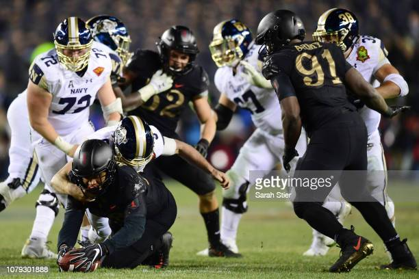 Kenneth Brinson of the Army Black Knights recovers a ball that was fumbled by the Navy Midshipmen during the third quarter of the game at Lincoln...