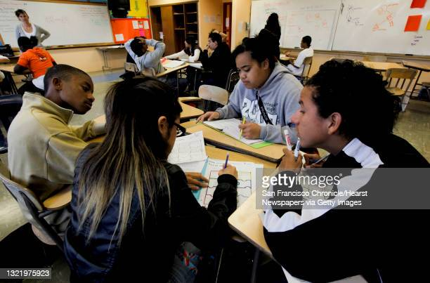 Kenneth Chappell, Santa Hernandez, Mu Savea and Edgar Acevedo working on a Humanities project during class, on Tuesday Sept. 14, 2010 at the June...