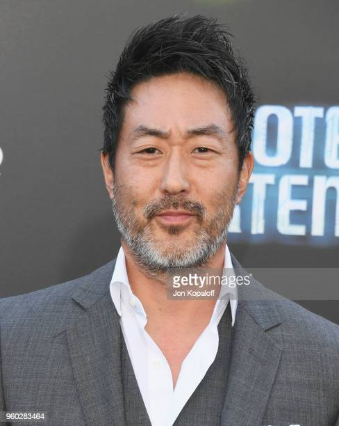 Kenneth Choi attends Global Road Entertainment's Hotel Artemis Premiere at Regency Village Theatre on May 19 2018 in Westwood California