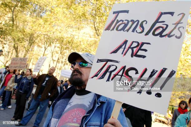 Kenneth Christy joins other protesters at an anti-trans fat rally in Thomas Paine Park as the Board of Health holds its first public hearing on a...