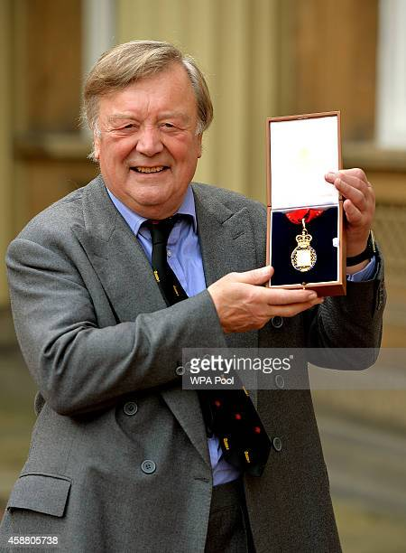 Kenneth Clarke holds his Companion of Honour award after the Investiture ceremony at Buckingham Palace on November 11, 2014 in London, England.