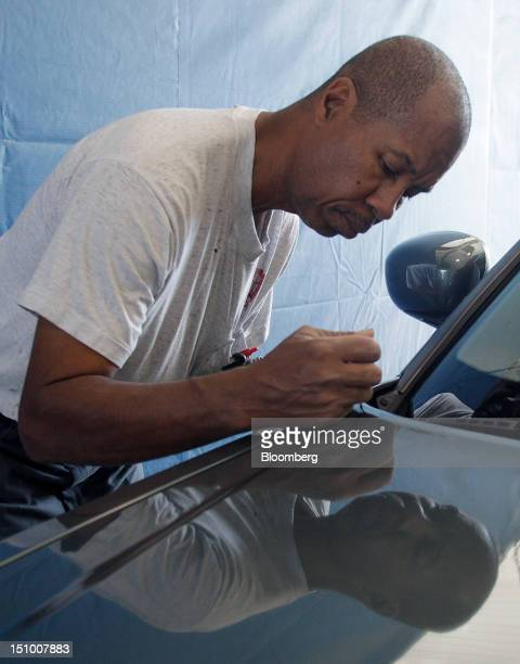 Kenneth Cunningham touches up a car with DuPont Co. Auto-paint at Haydocy Automotive in Columbus, Ohio, U.S., on Thursday, Aug. 30, 2012. Carlyle...