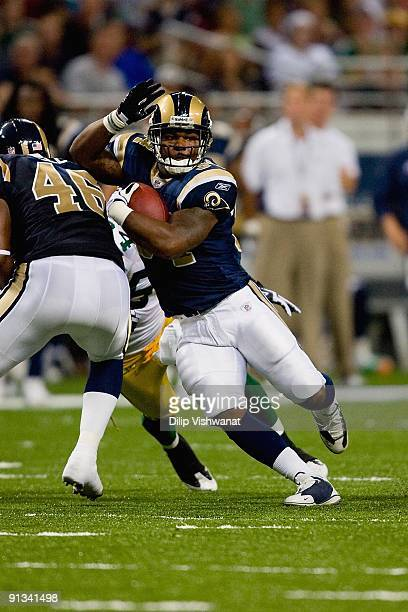 Kenneth Darby of the St Louis Rams carries the ball against the Green Bay Packers during the game at the Edward Jones Dome on September 27 2009 in St...