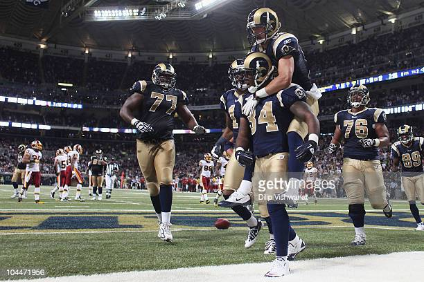 Kenneth Darby of the St Louis Rams is congratulated by teammate Danny Amendola after scoring a touchdown against the Washington Redskins at the...