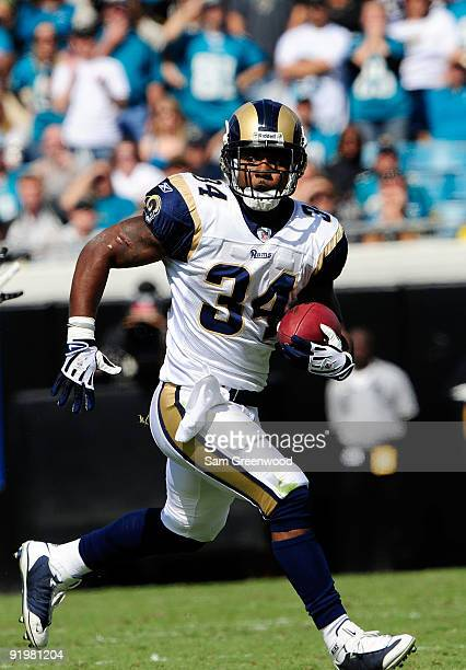 Kenneth Darby of the St Louis Rams runs for yardage against the Jacksonville Jaguars at Jacksonville Municipal Stadium on October 18 2009 in...
