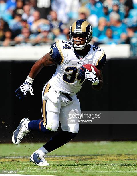 Kenneth Darby of the St Louis Rams runs for yardage during the game against the Jacksonville Jaguars at Jacksonville Municipal Stadium on October 18...