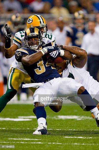 Kenneth Darby of the St Louis Rams rushes against the Green Bay Packers at the Edward Jones Dome on September 27 2009 in St Louis Missouri