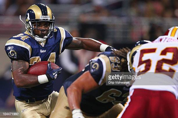 Kenneth Darby of the St Louis Rams rushes against the Washington Redskins at the Edward Jones Dome on September 26 2010 in St Louis Missouri The Rams...