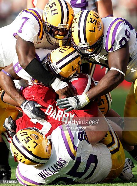 Kenneth Darby of the University of Alabama second from bottom is tackled by members of the Louisiana State University defense on November 12 2005 at...