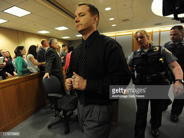 Kenneth Dion is escorted from an Anchorage courtroom on June 15 after a jury found him guilty on all counts of raping and murdering teenager Bonnie...