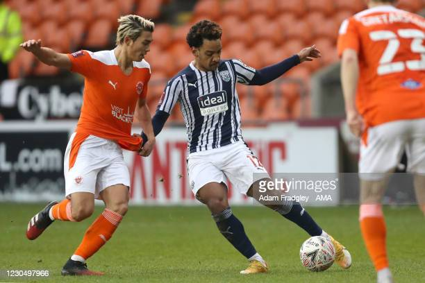 Kenneth Dougall of Blackpool and Matheus Pereira of West Bromwich Albion during the FA Cup Third Round match between Blackpool and West Bromwich...