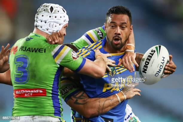 Kenneth Edwards of the Eels is tackled by Jarrod Croker of the Raiders during the round 11 NRL match between the Parramatta Eels and the Canberra...