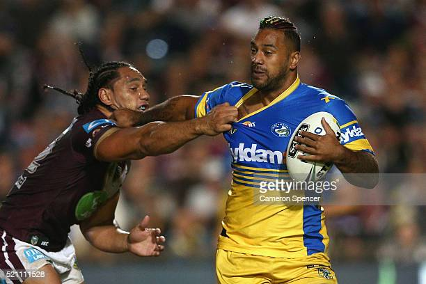 Kenneth Edwards of the Eels is tackled by Martin Taupau of the Sea Eagles during the round seven NRL match between the Manly Sea Eagles and...