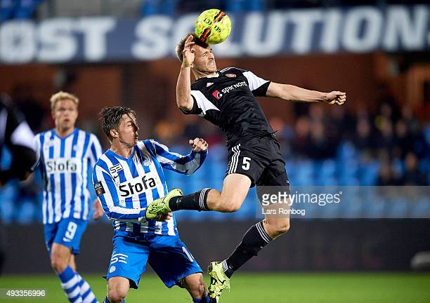 Kenneth Emil Petersen of AaB Aalborg and Nicki Bille Nielsen of Esbjerg compete for the ball during the Danish Alka Superliga match between Esbjerg...